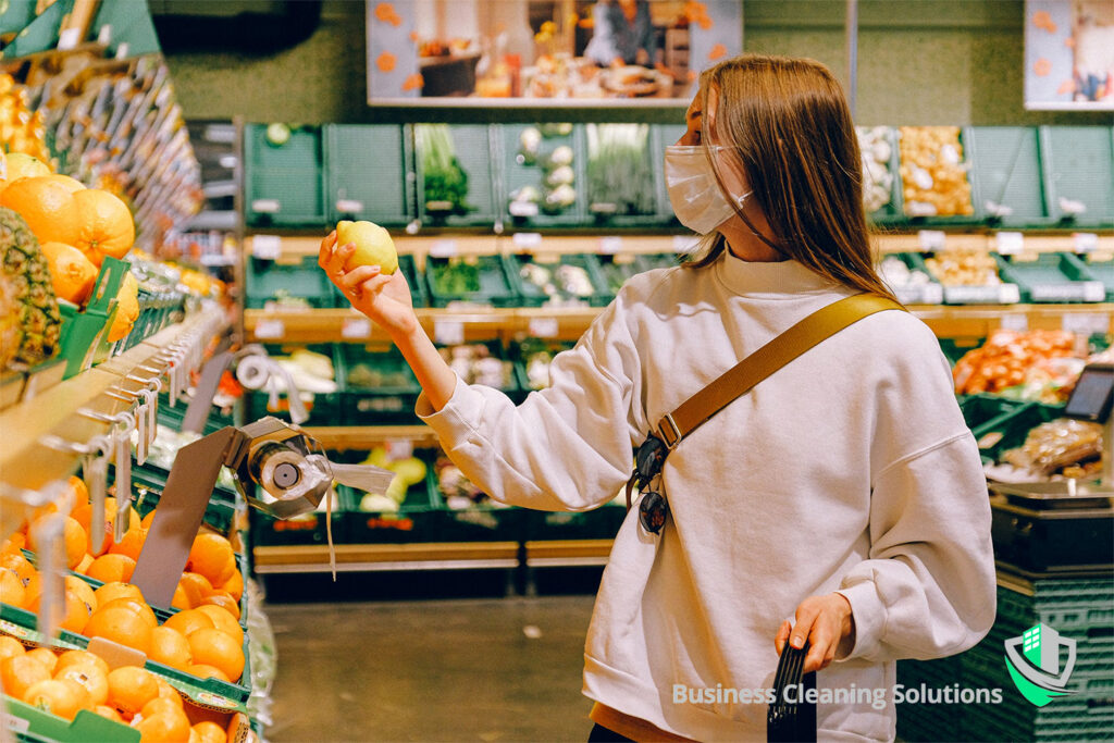 Woman wears a mask for health and safety while shopping for groceries