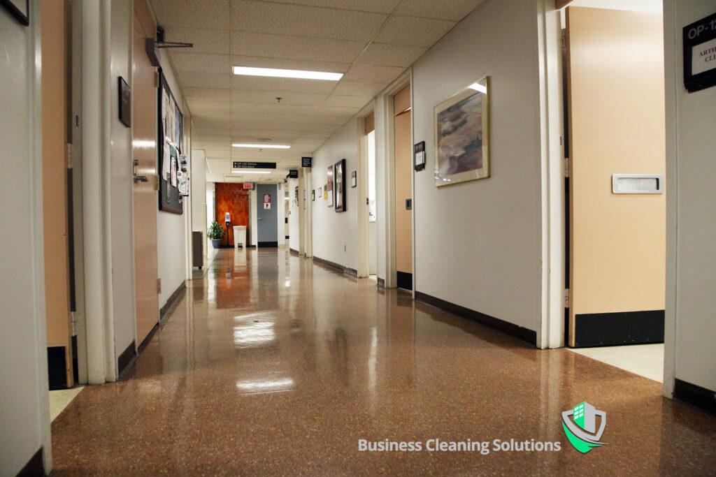 A high gloss sheet vinyl flooring in a commercial hallway.