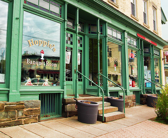 Clean commercial windows and clean exterior sidewalk areas.