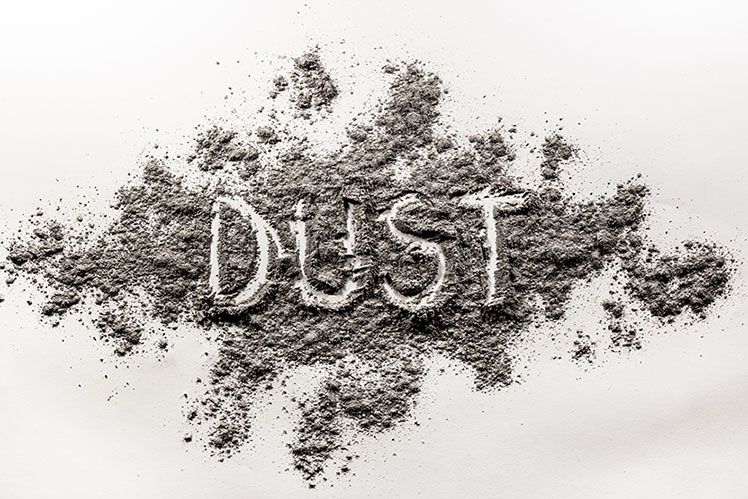 A large dust pile with the word dust written by someone's finger.