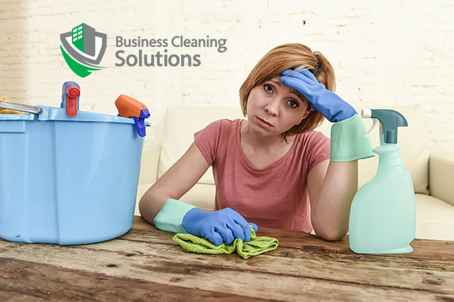 frustrated woman is overwhelmed trying to keep her business clean.