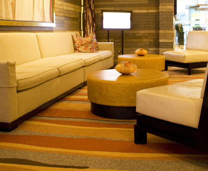 Clean commercial area rug and upholstered sofas