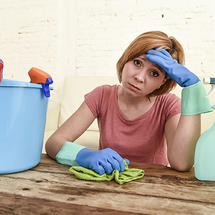 A frustrated businesswoman is tired of cleaning.