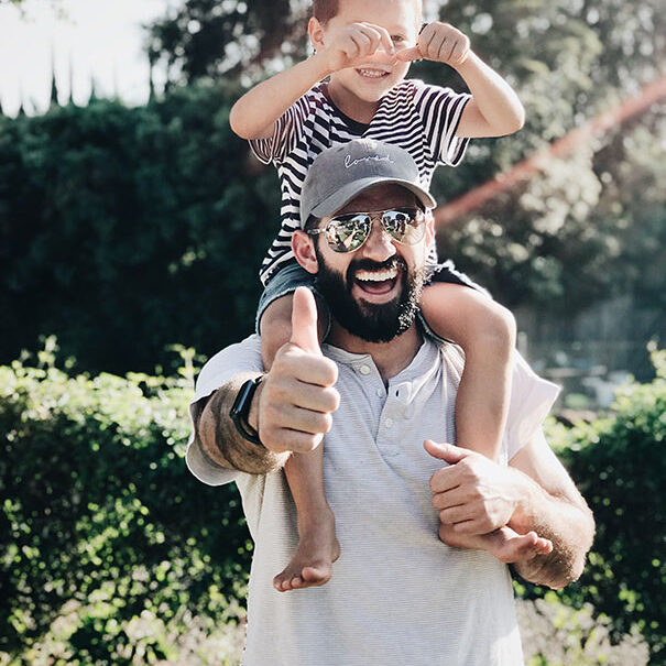 A happy father and son enjoy a fun shoulder ride