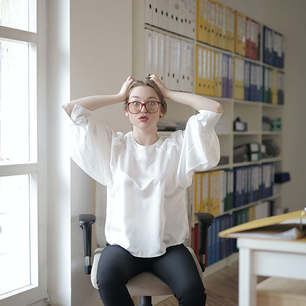 Frustrated office professional tries to keep her office disinfected.