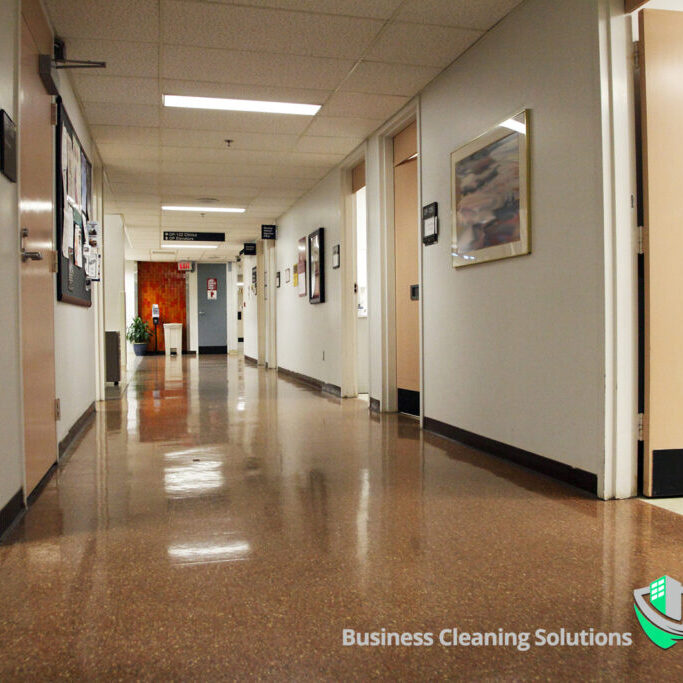 Well maintained vinyl flooring in a commercial hallway.
